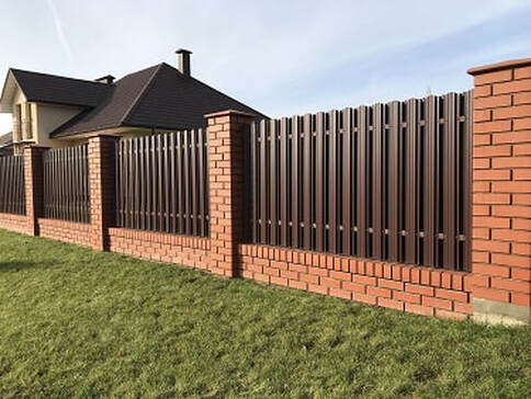 Southwest view of the newly installed black colour aluminium fencing for a residential area in Ballarat, VIC.